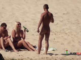 Barely legal youthful naturist lays naked at the strand