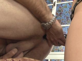 Brunette femdom drilling slave's ass with strapon