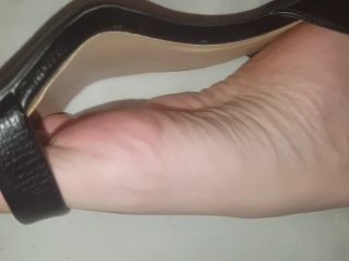 Foot tease in and out of sexy high heels