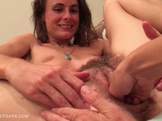 Fist and toys in hairy pussy of lesbians
