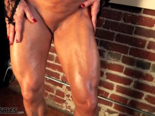 Kathy Connors Showing her Muscled Pussy