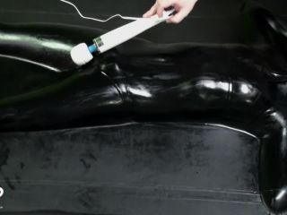 Miss Perversion Gets Teased in a Latex Vacbed