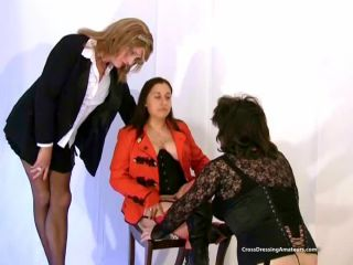 Female photographed with older crossdressers