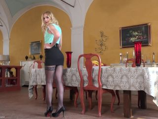 With a combination of nicely fitting dress and pantyhose on full figur ...