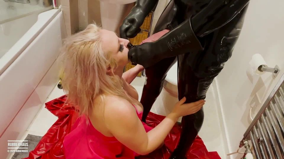 Filthy rubber girl eats shit and receives a face load of cum with RubberHaus