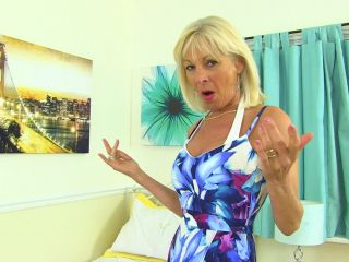 British mature lady Elaine playing with a banana on holiday | mature & granny | mature