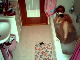 Wife relaxing in the bathtube. hidden cam