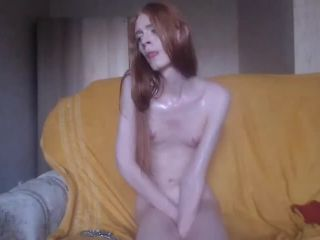 Sexy redhead femboy oiling her body and stroke